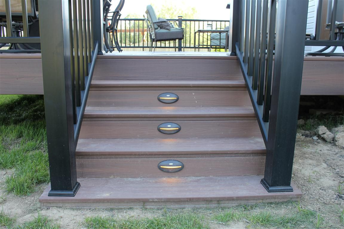 This Deck Included Composite Flooring And Facia Along With A Composite  Railing With LED Post Tops. We Also Added Some LED Riser Lights To The Steps .